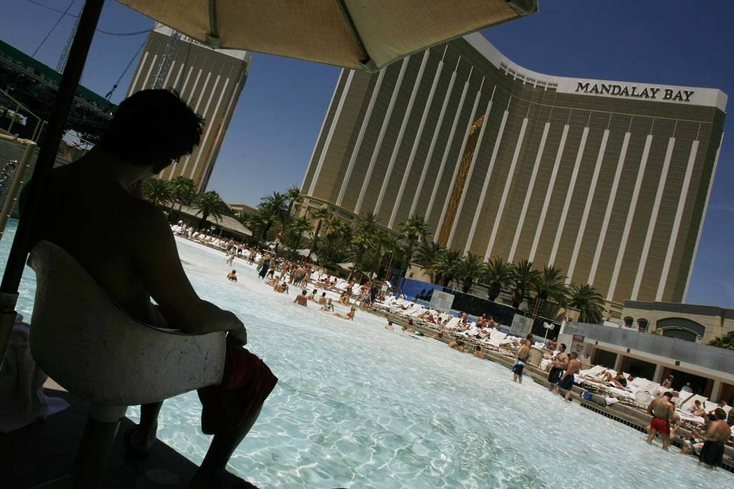 A life guard keeps an eye on guests at the Mandalay Bay pool in Las Vegas on Thursday, June 1, 2006. (Isaac Brekken/Las Vegas Review-Journal)
