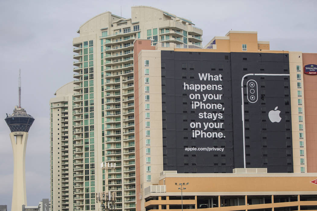 An Apple advertisement on the south side of SpringHill Suites is easily visible from the CES 2019 tech show at the Las Vegas Convention Center on Monday, Jan. 7, 2019, in Las Vegas. Benjamin Hager ...