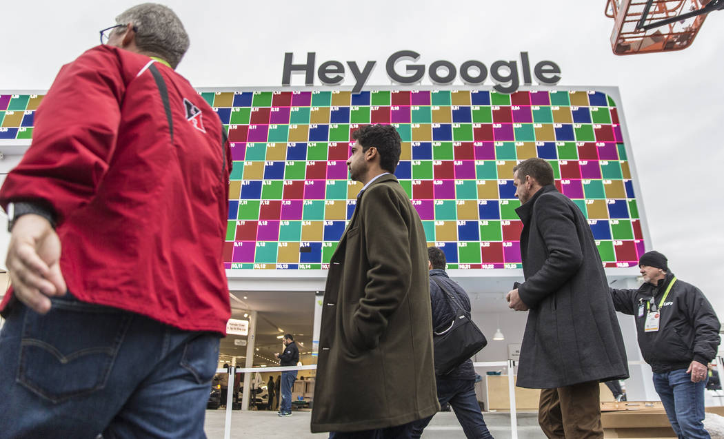 Visitors walk past Google's promotional space outside the Las Vegas Convention Center on the eve of opening day of CES 2019 on Monday, Jan. 7, 2019, in Las Vegas. The four day tech event brings ov ...