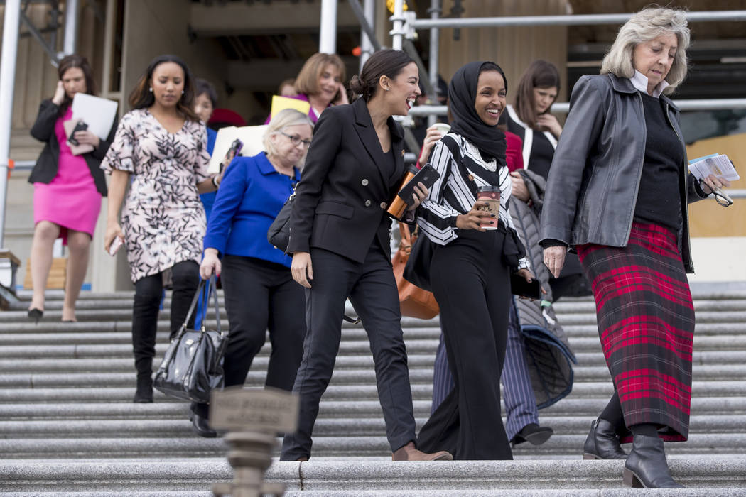 Rep. Dina Titus, D-Nev., right, walks down the steps of the U.S. House of Representatives on Friday following a group photo of House Democratic women members of the 116th Congress. Rep. Alexandria ...