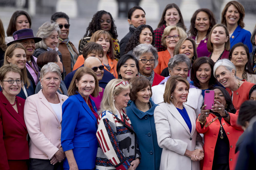House Speaker Nancy Pelosi of Calif., bottom, second from right, smiles as Rep. Terri Sewell, D-Ala., bottom right, takes a selfie with the House Democratic women members of the 116th Congress on ...