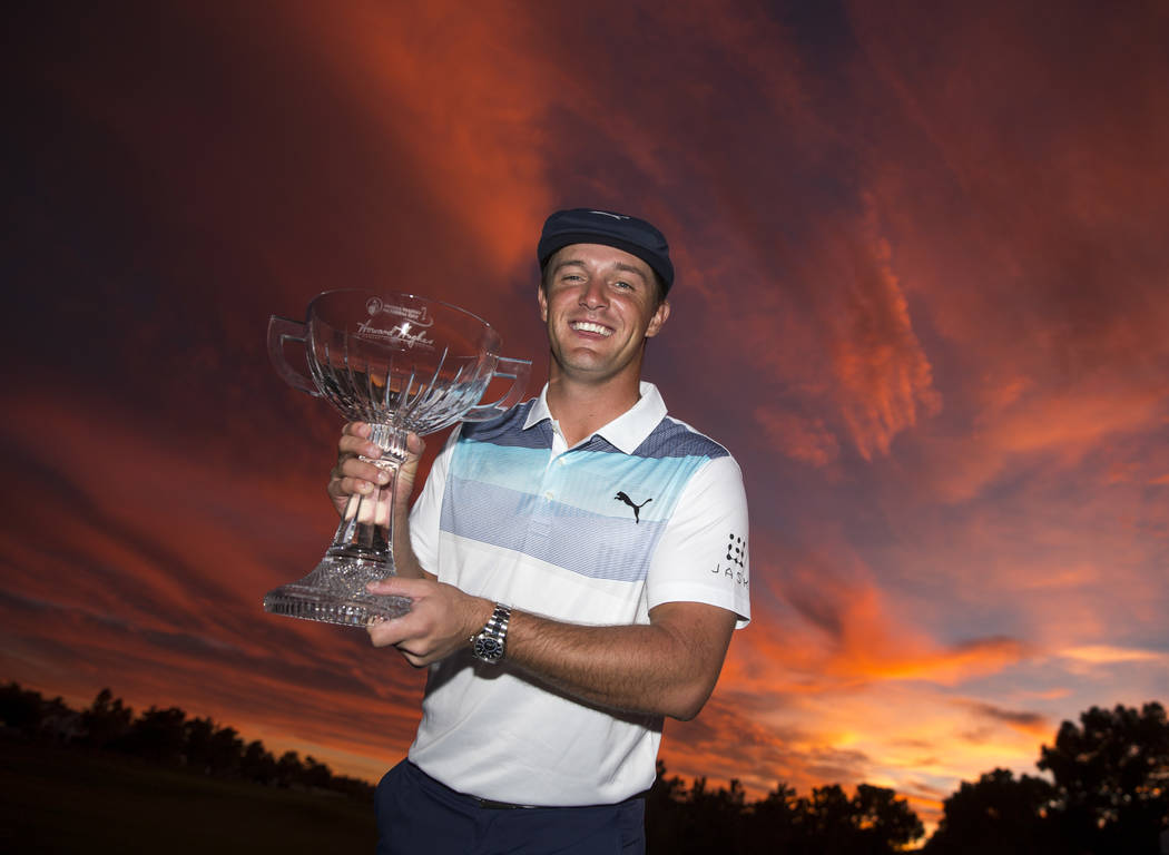 American golfer Bryson DeChambeau poses with the trophy after winning the Shriners Hospitals for Children Open at TPC at Summerlin in Las Vegas on Sunday, Nov. 4, 2018. Richard Brian Las Vegas Rev ...