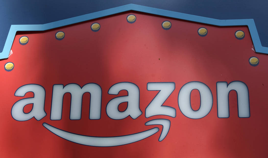 FILE - This Oct. 23, 2018, file photo shows an Amazon logo atop the Amazon Treasure Truck The Park DTLA office complex in downtown Los Angeles. Amazon has eclipsed Microsoft as the most valuable p ...