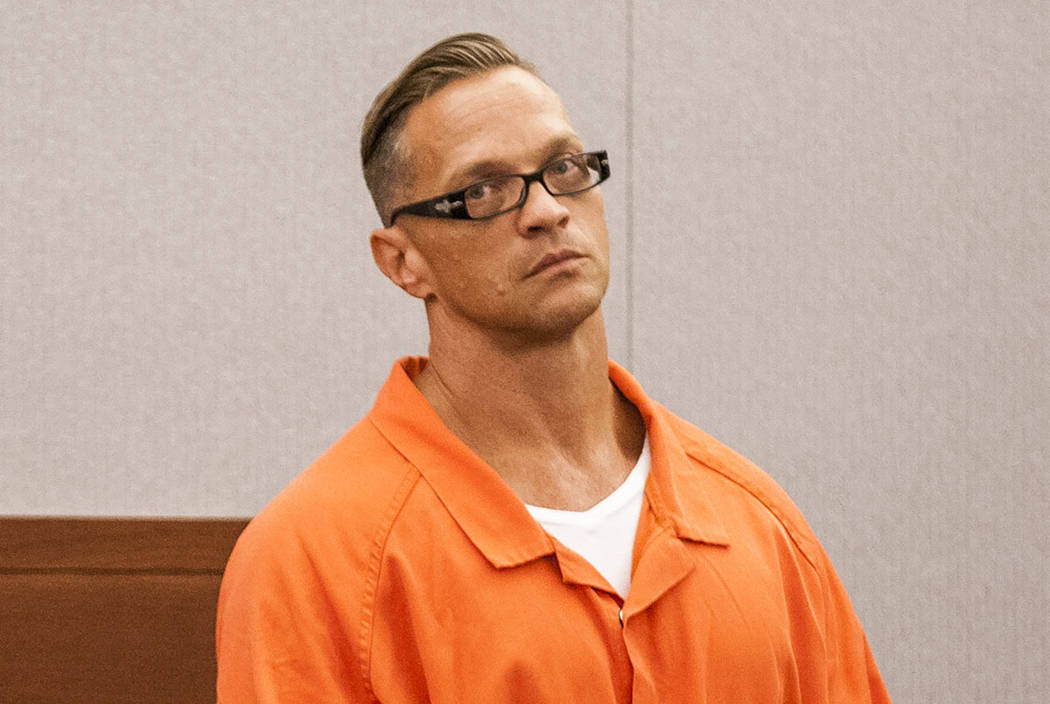 Two-time killer Scott Dozier stands for a hearing about his death sentence at the Regional Justice Center on Thursday, July 27, 2017. (Las Vegas Review-Journal)
