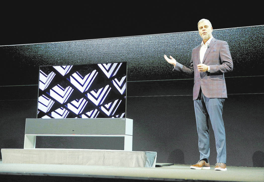 David VanderWaal, vice president of marketing for LG Electronics USA, unveils the LG Signature OLED TV R during an LG news conference at CES International, Monday, Jan. 7, 2019, in Las Vegas. (AP ...