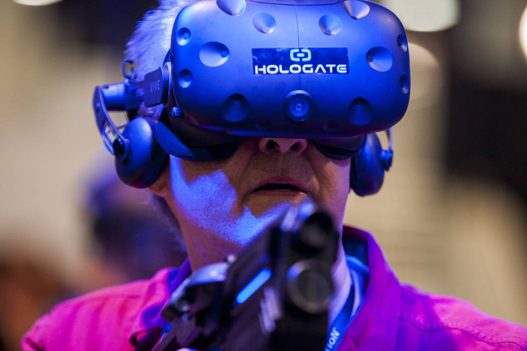 Charles Womack tries out a virtual reality game at the Las Vegas Convention Center on Tuesday, March 27, 2018. Patrick Connolly Las Vegas Review-Journal @PConnPie