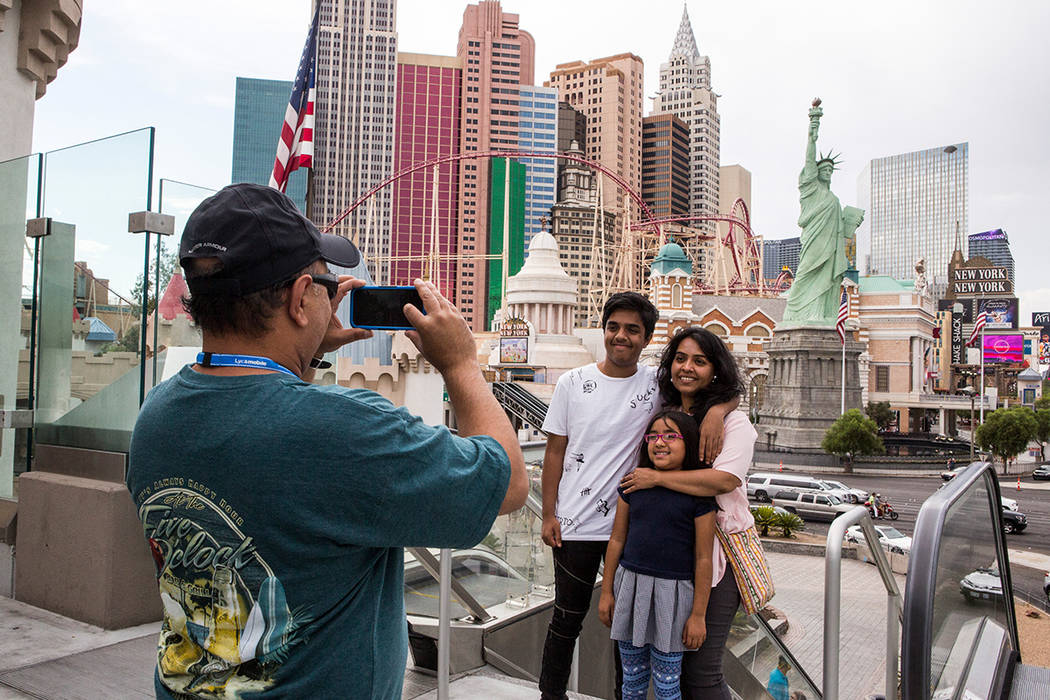 Ashish Mehta takes a photo of his wife Ami and children Arnav, 14, and Veda, 7, on the Las Vegas Strip. The family was visiting from Illinois. Patrick Connolly/ Las Vegas Review-Journal