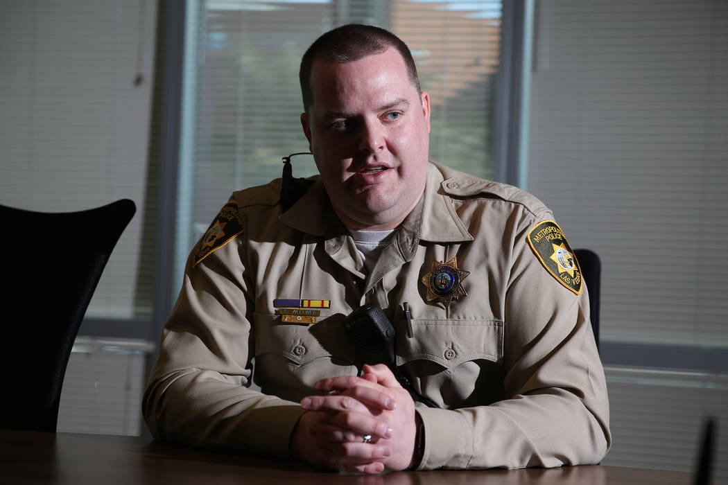 Las Vegas police gang enforcement officer Samuel Wittwer, who broke his leg while responding to the Oct. 1, 2017, shooting, is interviewed at Metropolitan Police Department headquarters on Friday, ...