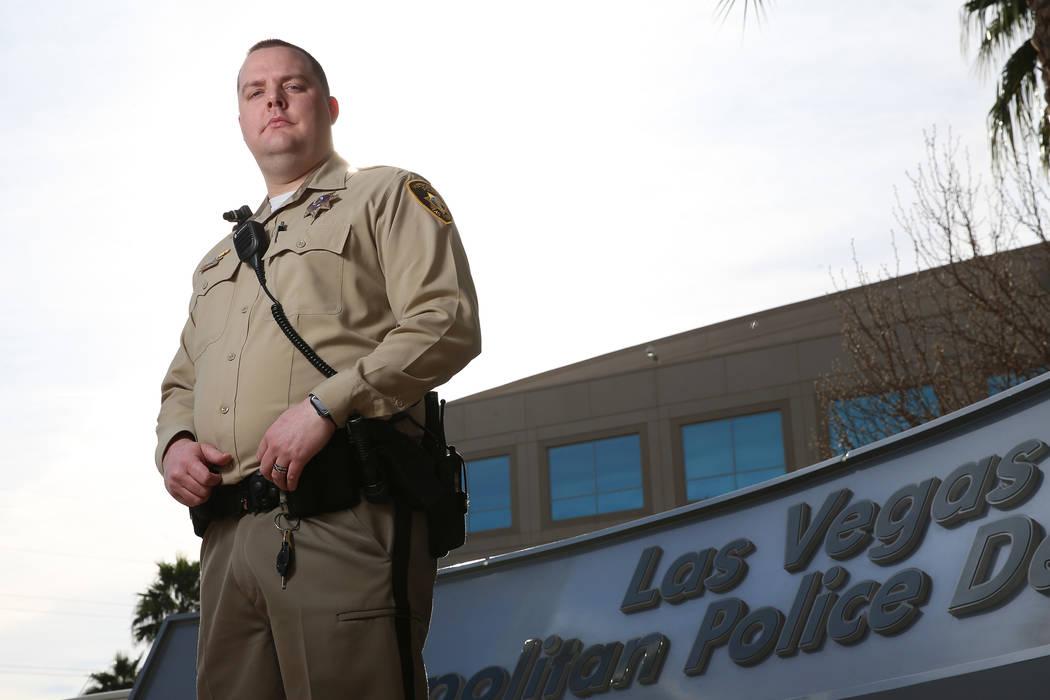 Las Vegas police gang enforcement officer Samuel Wittwer poses for a portrait outside Las Vegas Metropolitan Police Department headquarters on Friday, Jan. 11, 2019. Wittwer broke his leg while re ...