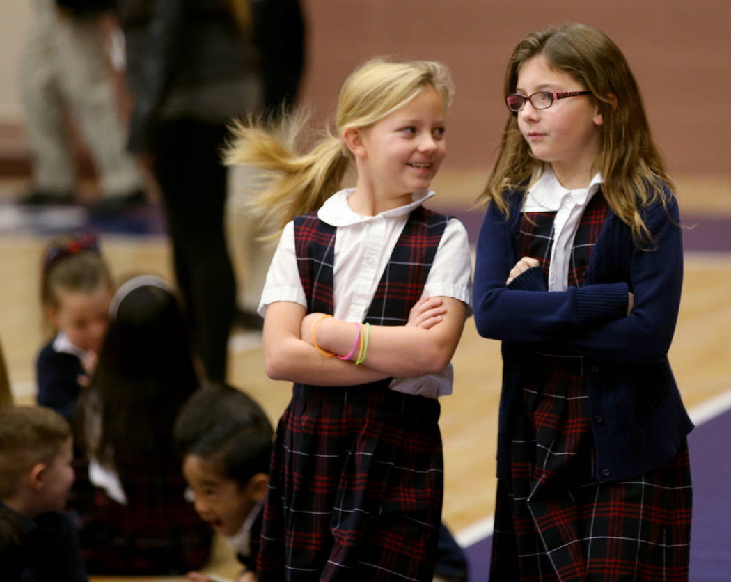 Students including third graders Tessa Strobehn, left, and Nadia Cullison gather for an assembly in the gym at American Preparatory Academy charter school in Las Vegas Thursday, Jan. 3, 2019. K.M ...