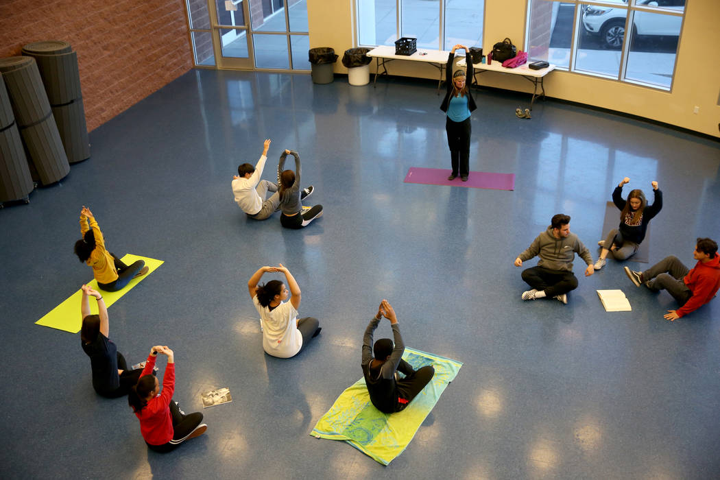 Lisa Cates teaches yoga at American Preparatory Academy charter school in Las Vegas Thursday, Jan. 3, 2019. The class was part of the Winterim term which runs Jan. 3-18 where students can explore ...