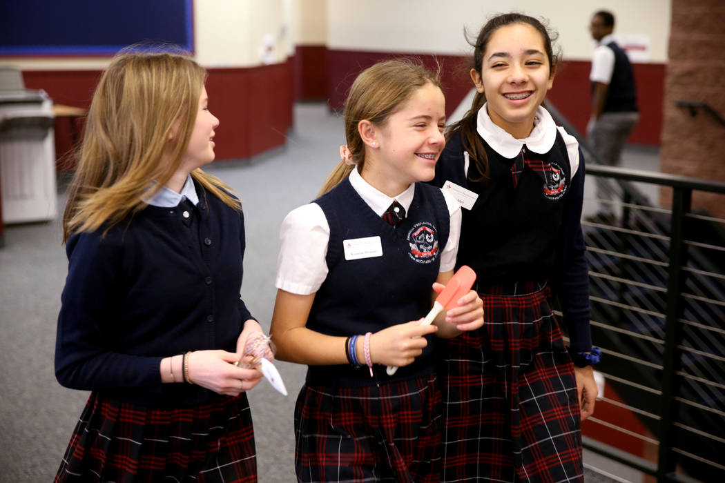 Seventh graders Emery Anderson, from left, Kennedy Herman and Jaylin Adair between classes at American Preparatory Academy charter school in Las Vegas Thursday, Jan. 3, 2019. K.M. Cannon Las Vegas ...