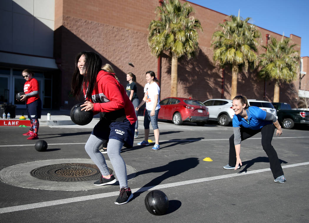 Tami Clark, right, teaches cardio and weightlifting class at American Preparatory Academy charter school in Las Vegas Thursday, Jan. 3, 2019. The class was part of the Winterim term which runs Jan ...