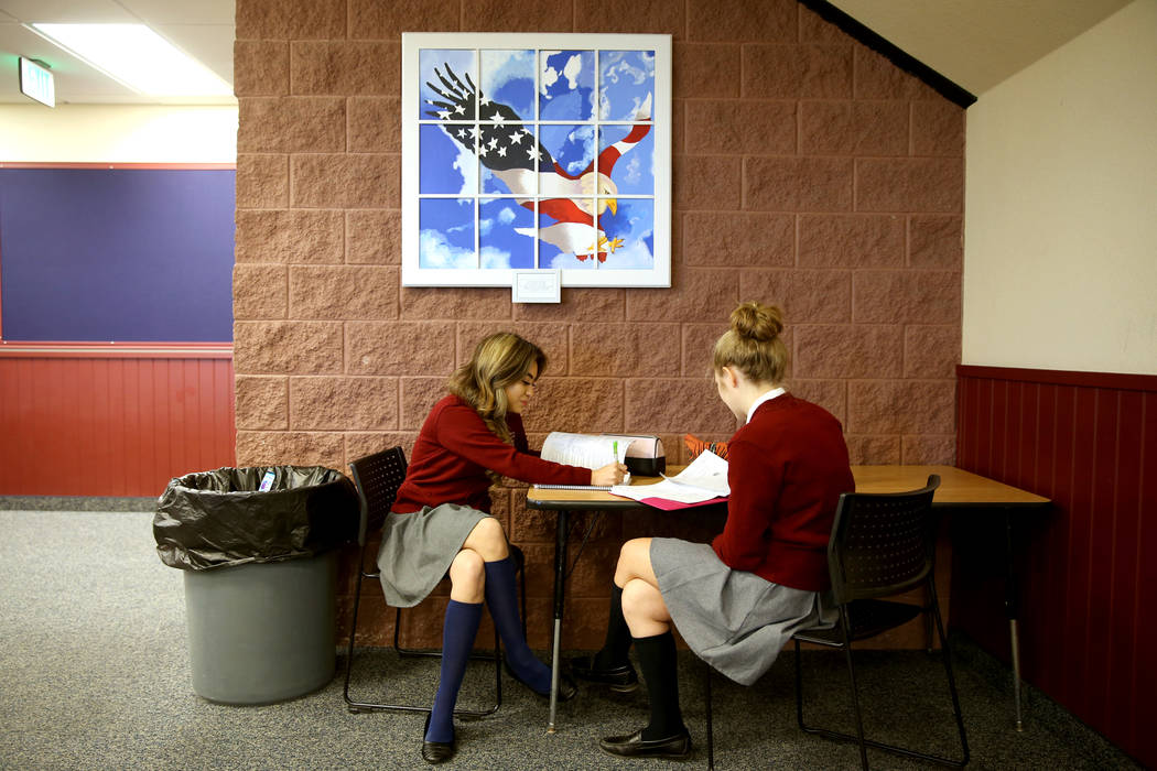 Lulu Gonzalez, left, and Emily Baldau have a study session in the hall at American Preparatory Academy charter school in Las Vegas Thursday, Jan. 3, 2019. K.M. Cannon Las Vegas Review-Journal @KMC ...
