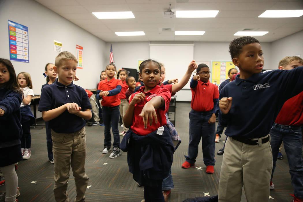 Second grade students sing and dance inside their classroom at Legacy Traditional School in North Las Vegas, on Thursday, Jan. 10, 2019. Erik Verduzco Las Vegas Review-Journal @Erik_Verduzco