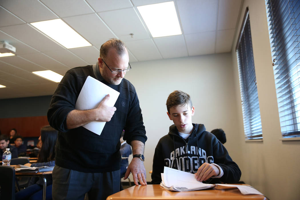 Don Nordstrom checks the work of his student David Drummond, 13, during science class at Legacy Traditional School in North Las Vegas, on Thursday, Jan. 10, 2019. Erik Verduzco Las Vegas Review-Jo ...