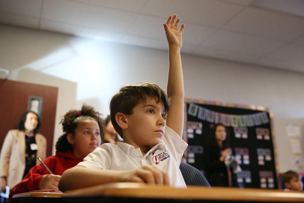 Braydon Vohs raises his hand during his third grade math class at Legacy Traditional School in North Las Vegas, on Thursday, Jan. 10, 2019. Erik Verduzco Las Vegas Review-Journal @Erik_Verduzco