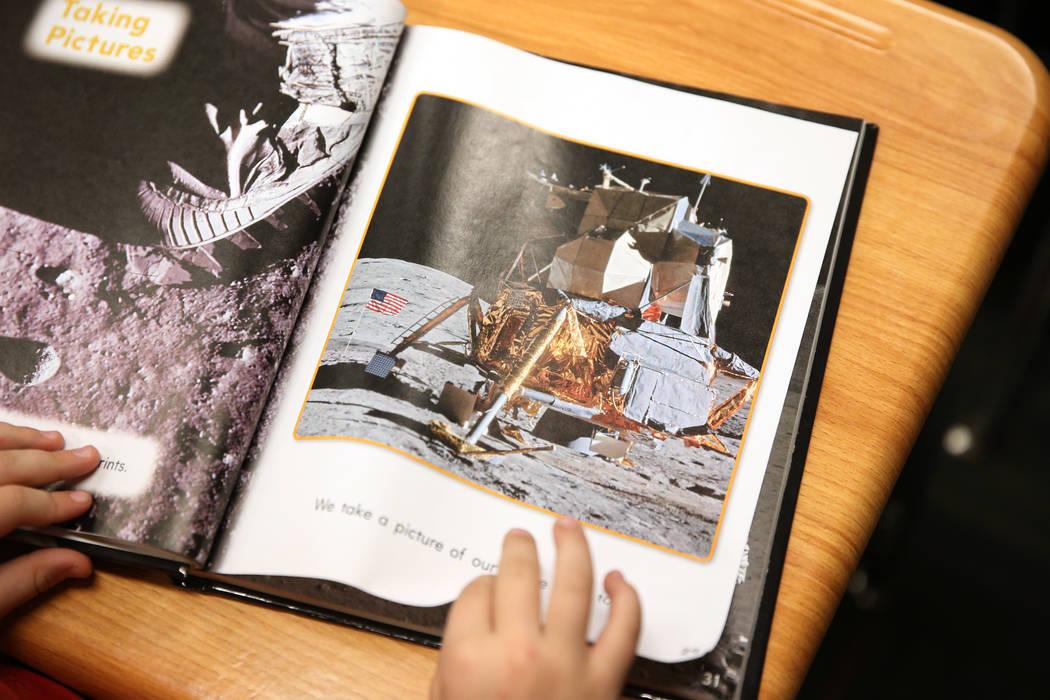 A first grade student looks at her book at Legacy Traditional School in North Las Vegas, on Thursday, Jan. 10, 2019. Erik Verduzco Las Vegas Review-Journal @Erik_Verduzco
