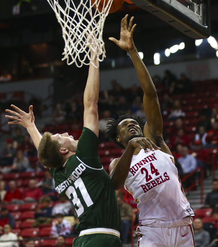 UNLV Rebels forward Joel Ntambwe (24) goes to the basket against Colorado State forward Adam Thistlewood (31) during the second half of a basketball game at the Thomas & Mack Center in Las Veg ...