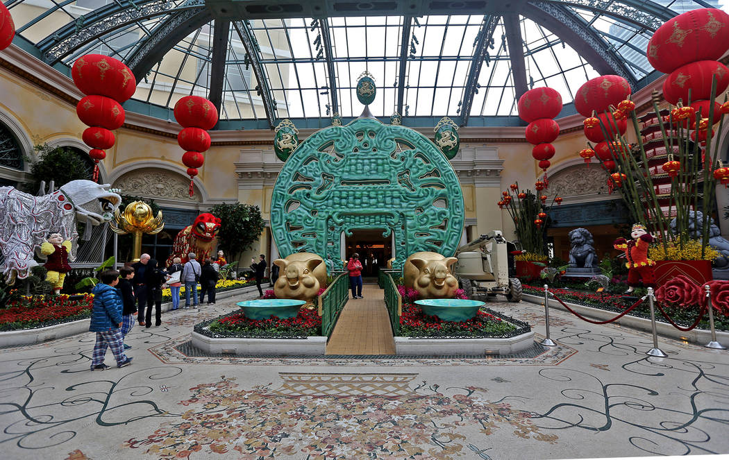 A 20 foot high jade coin at the Chinese New Year Year of the Pig display at the Bellagio Conservatory at the Bellagio in Las Vegas, Monday, Jan. 14, 2019. Rachel Aston Las Vegas Review-Journal @ro ...