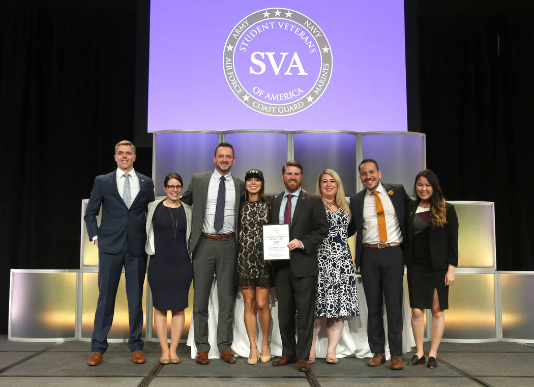 Student Veteran of the Year Alexandria Sawin is joined by previous award winners as she is presented with her honor by Jared Lyon, President and CEO of Student Veterans of America. (Photo by Robb ...