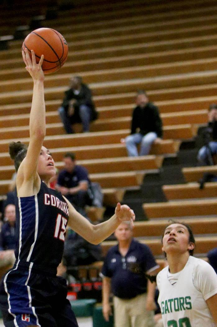 Coronado High School's Gabriela Etopio (15) attempts a basket against Green Valley High School at Green Valley High School in Henderson, Monday, Jan. 7, 2019. Rachel Aston Las Vegas Review-Journal ...