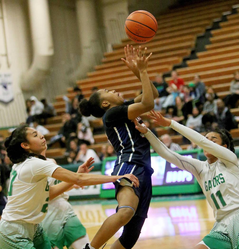 Coronado High School's Sade Williams (23) attempts a basket against Green Valley High School's Lusi Soifua (11) at Green Valley High School in Henderson, Monday, Jan. 7, 2019. Rachel Aston Las Veg ...