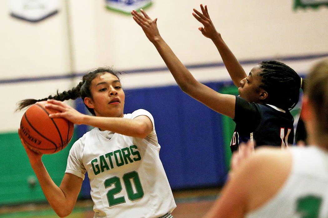 Green Valley High School's Michelle Lagunas-Monroy (20) tries to pass through Coronado High School's Tia Thorton (11) at Green Valley High School in Henderson, Monday, Jan. 7, 2019. Rachel Aston L ...