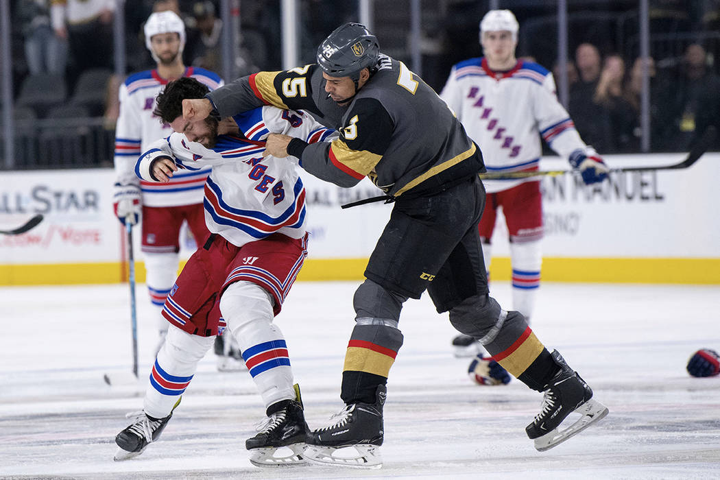 Vegas Golden Knights right wing Ryan Reaves and New York Rangers defenseman Adam McQuaid fight during the third period of an NHL hockey game Tuesday, Jan. 8, 2019, in Las Vegas. (AP Photo/Eric Jam ...