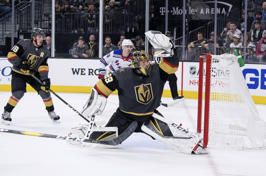 Vegas Golden Knights goalie Marc-Andre Fleury makes a save against the New York Rangers during the third period of an NHL hockey game Tuesday, Jan. 8, 2019, in Las Vegas. The Knights defeated the ...