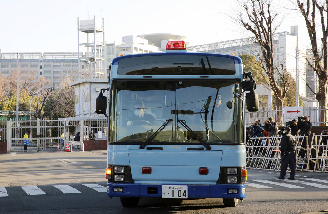 A vehicle presumably carrying former Nissan chairman Carlos Ghosn leaves Tokyo Detention Center in Tokyo Tuesday, Jan. 8, 2019. Ghosn is getting his day in court to demand the reason for his prolo ...