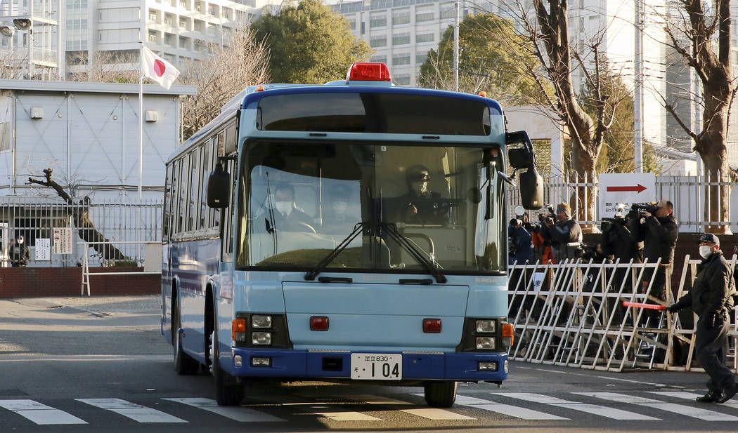 A vehicle presumably carrying former Nissan chairman Carlos Ghosn leaves Tokyo Detention Center in Tokyo, Tuesday, Jan. 8, 2019. Ghosn is getting his day in court to demand the reason for his prol ...