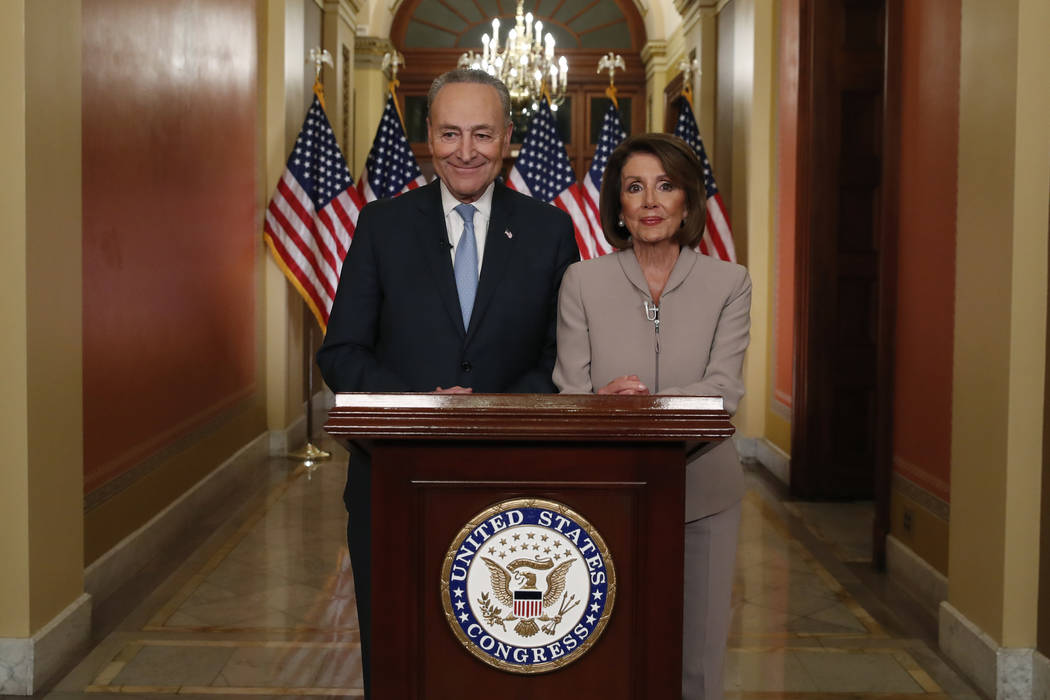 House Speaker Nancy Pelosi of Calif., and Senate Minority Leader Chuck Schumer of N.Y., pose for photographers after speaking on Capitol Hill in response President Donald Trump's prime-time addres ...