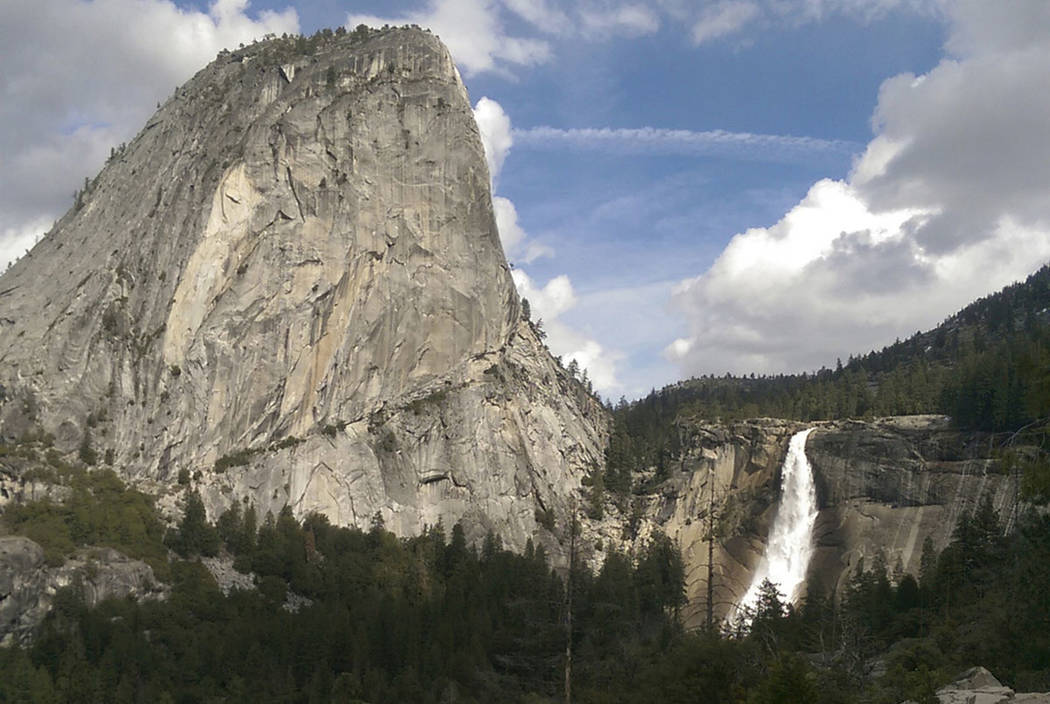 Water flows over the Nevada Fall near Liberty Cap as seen from the John Muir Trail in Yosemite National Park, Calif.on March 28, 2016. (National Park Service via AP, File)