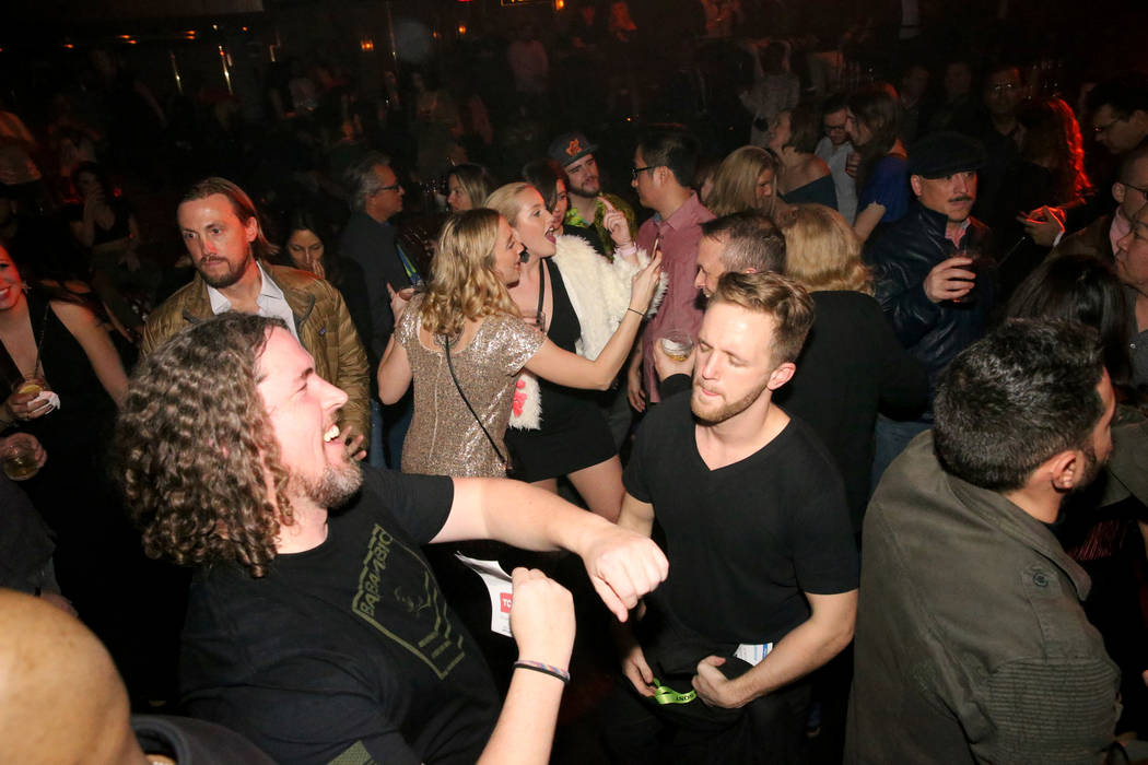 Conventioneers Tyler Slack of Orem, Utah, left, and John-Luke Laube of New York dance at the CES 2019 C Space Party presented by Jewel Nightclub at Aria in Las Vegas Monday, Jan. 7, 2019. K.M. Can ...