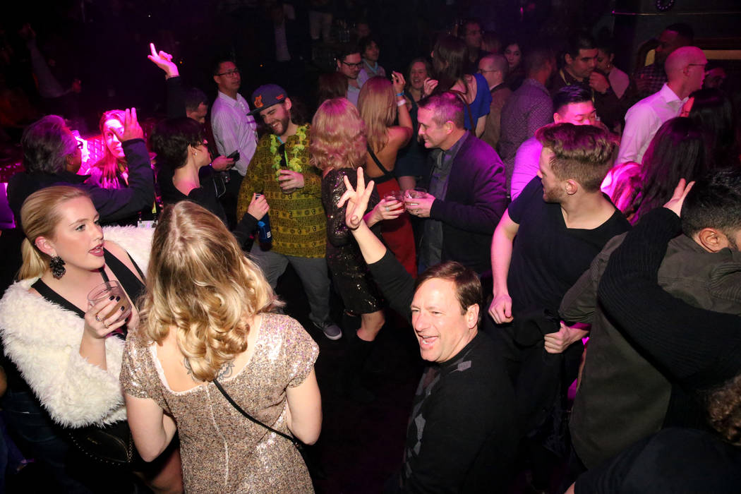 Conventioneer Joseph Jacques of Green Bay, Wis., right, dances at the CES 2019 C Space Party presented by Jewel Nightclub at Aria in Las Vegas Monday, Jan. 7, 2019. K.M. Cannon Las Vegas Review-Jo ...