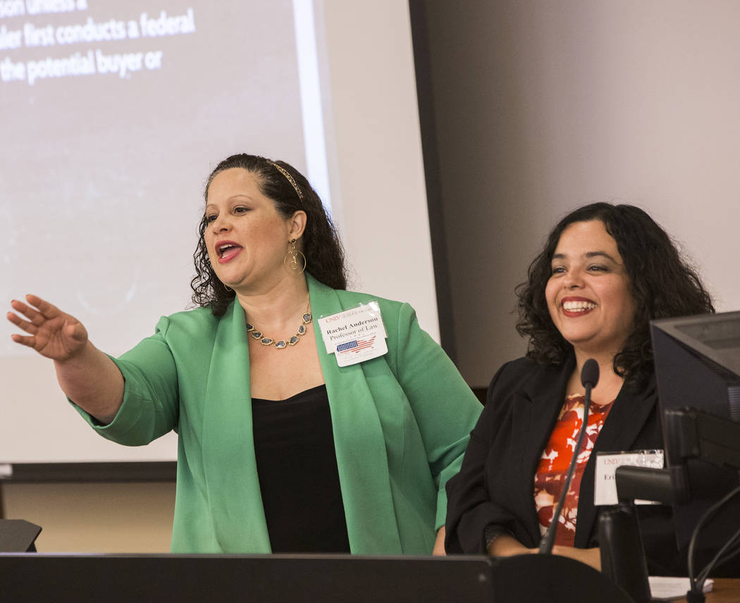 Dr. Rachel Anderson, left, a law professor at UNLV, and Dr. Erika Marquez, of the Kenny Guinn Center for Policy Priorities, answer questions at a gun reform presentation at UNLV, Sept. 14, 2016. A ...