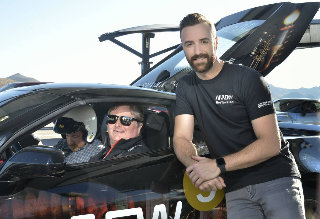 Former IndyCar driver Sam Schmidt, owner of Schmidt Peterson Motorsports, center, and IndyCar driver James Hinchcliffe, right, are shown as Schmidt prepares to take passenger Sean McGee, left, for ...