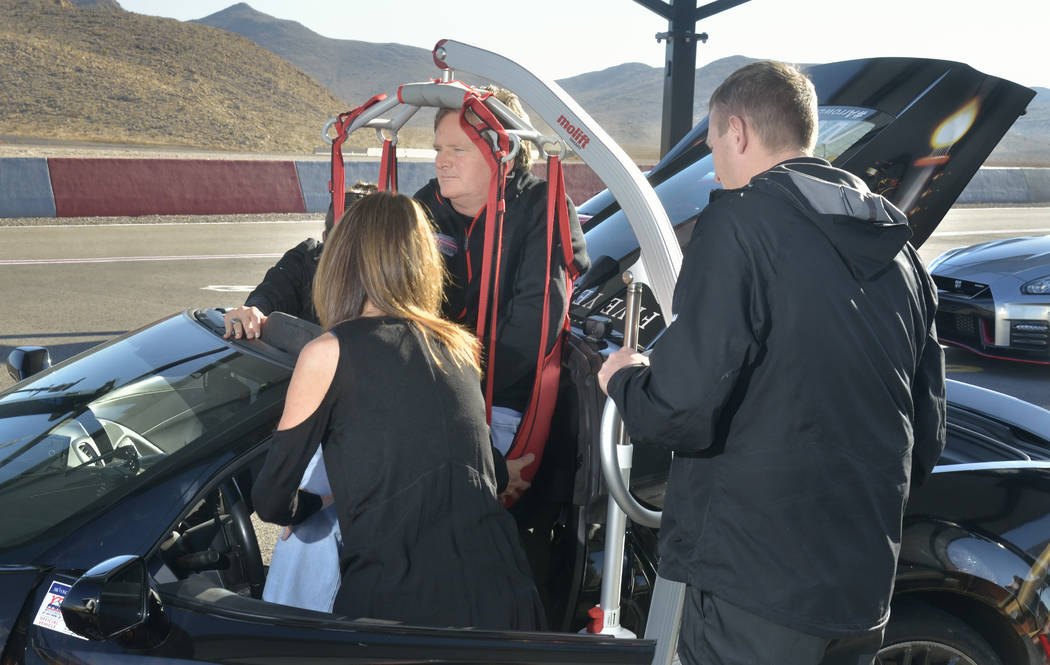 Former IndyCar driver Sam Schmidt, who now owns Schmidt Peterson Motorsports, is hoisted into a specially equipped car which allows him to drive at Speed Vegas at 14200 S. Las Vegas Blvd. in Las V ...