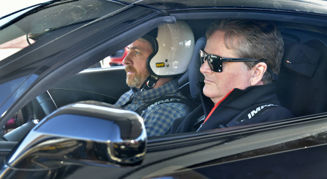 Passenger Sean McGee, left, prepares to go for a ride with former IndyCar driver Sam Schmidt, who now owns Schmidt Peterson Motorsports, at Speed Vegas at 14200 S. Las Vegas Blvd. in Las Vegas on ...
