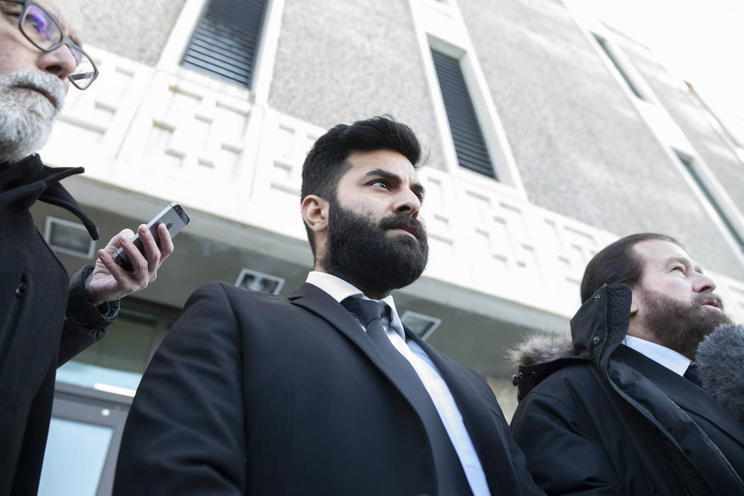Jaskirat Singh Sidhu, center, leaves provincial court in Melfort, Saskatchewan, Tuesday, Jan. 8, 2019. Sidhu, the driver of a transport truck involved in a bus crash that killed 16 people with the ...