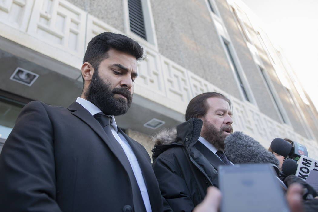 Jaskirat Singh Sidhu leaves provincial court with his lawyer Mark Brayford, right, in Melfort, Saskatchewan, Tuesday, Jan. 8, 2019. Sidhu, the driver of a transport truck involved in a bus crash t ...