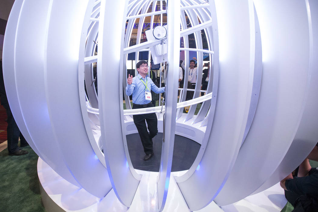 Woo Hyun Lim of South Korea dances in a video booth part of Samsung's Galaxy Experience Zone on day one of CES at the Las Vegas Convention Center in Las Vegas on Tuesday, Jan. 8, 2019. Richard Bri ...
