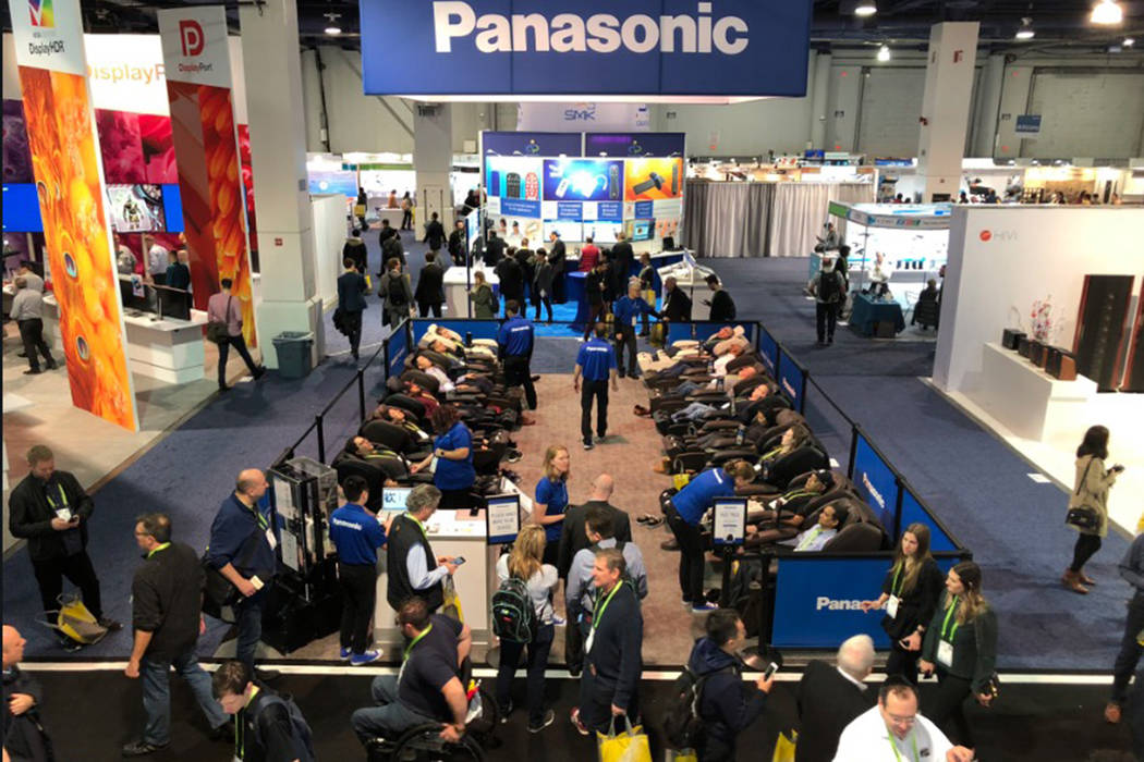 Rows of CES goers enjoy the Panasonic Real Pro Ultra massage chair in Las Vegas on Tuesday, Jan. 8, 2019. (Benjamin Hager/Las Vegas Review-Journal)