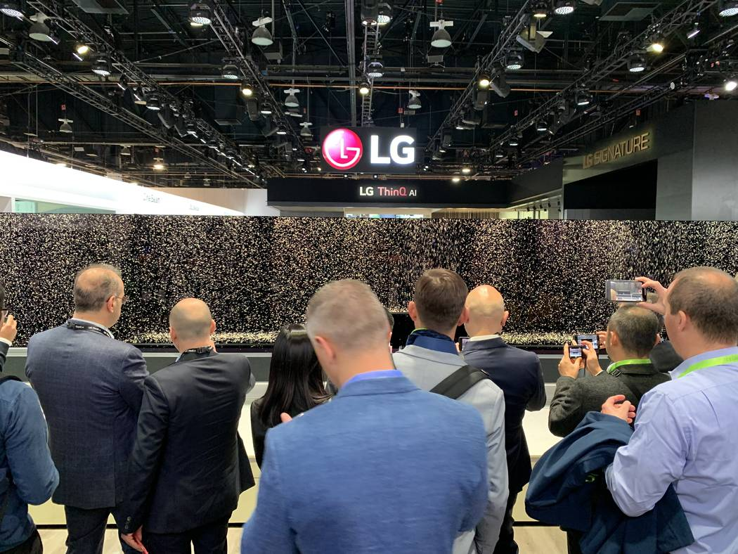 People lining up at the LG booth at CES at the Las Vegas Convention Center to see their new rollable TV screen on Tuesday, Jan. 8, 2018 in Las Vegas. Todd Prince/Las Vegas Review-Journal