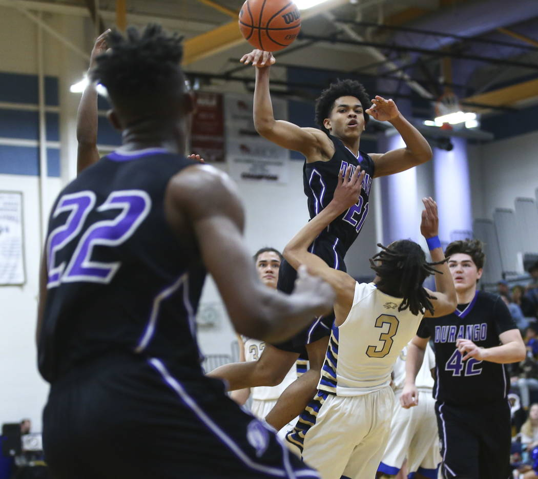 Durango's Anthony Hunter (21) passes the ball to Durango's Vernell Watts (22) during a basketball game at Sierra Vista High School in Las Vegas on Thursday, Feb. 8, 2018. Chase Stevens Las Vegas R ...