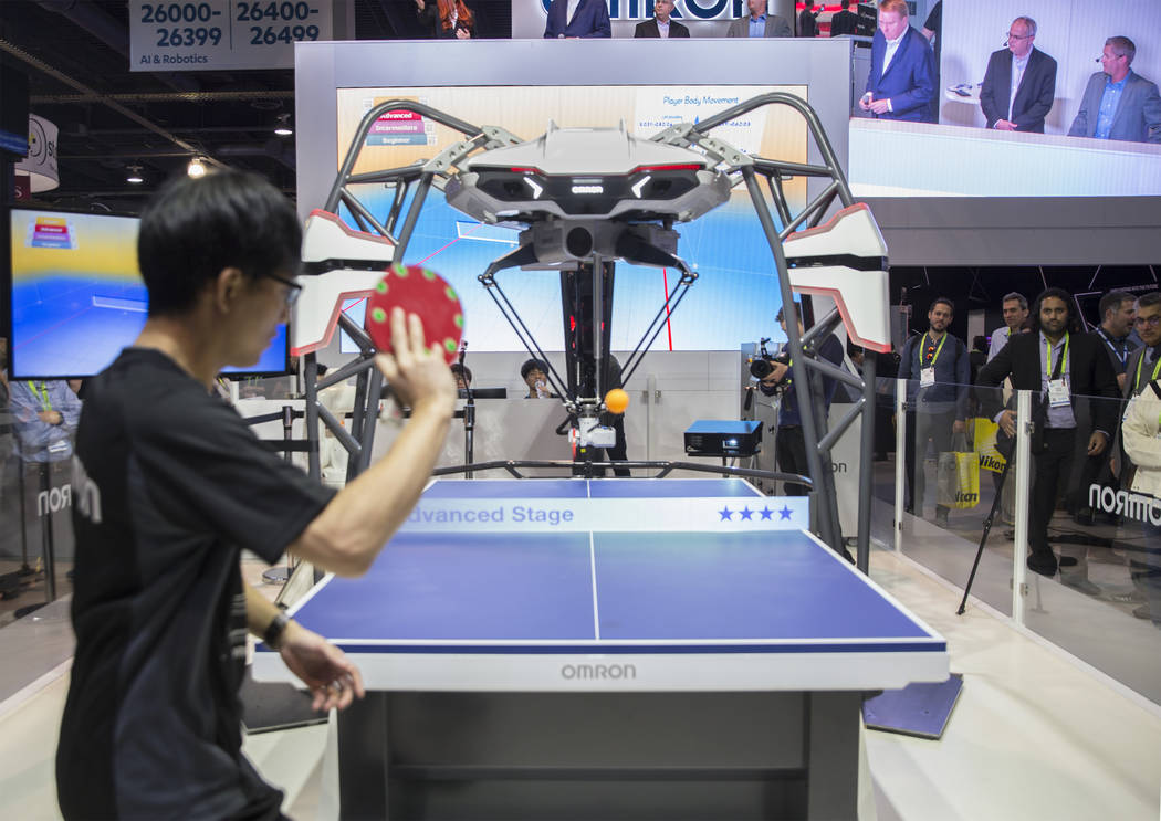 OMRONÕs Forpheus robot plays an exhibitor in a game of table tennis during the first day of CES 2019 on Tuesday, Jan. 8, 2019, at the Las Vegas Convention Center, in Las Vegas. The four day t ...