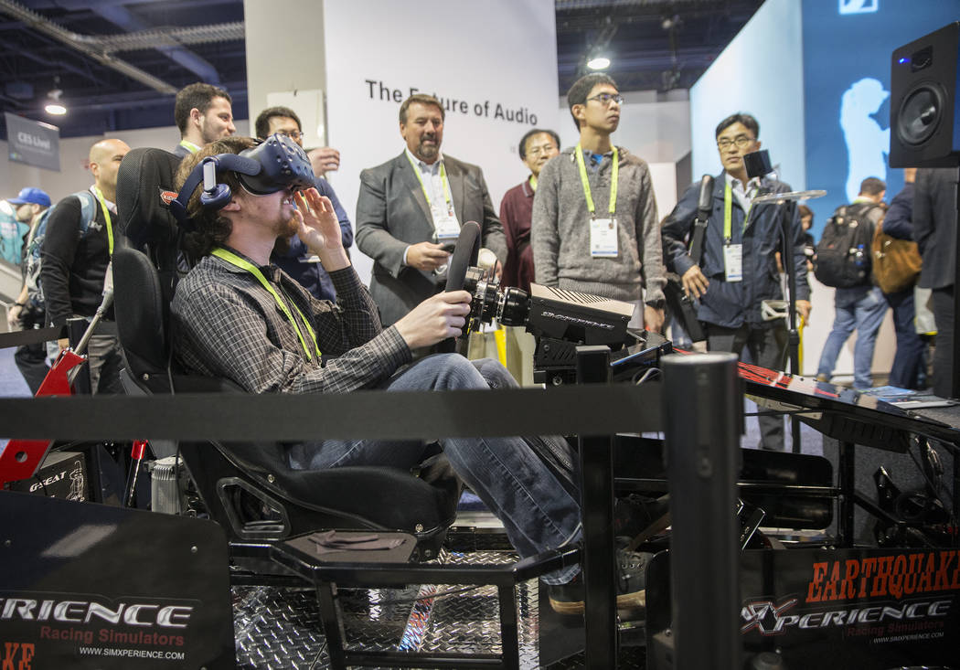 Mark Giambone explores the Earthquake Experience virtual reality video game during the first day of CES 2019 on Tuesday, Jan. 8, 2019, at the Las Vegas Convention Center, in Las Vegas. The four da ...