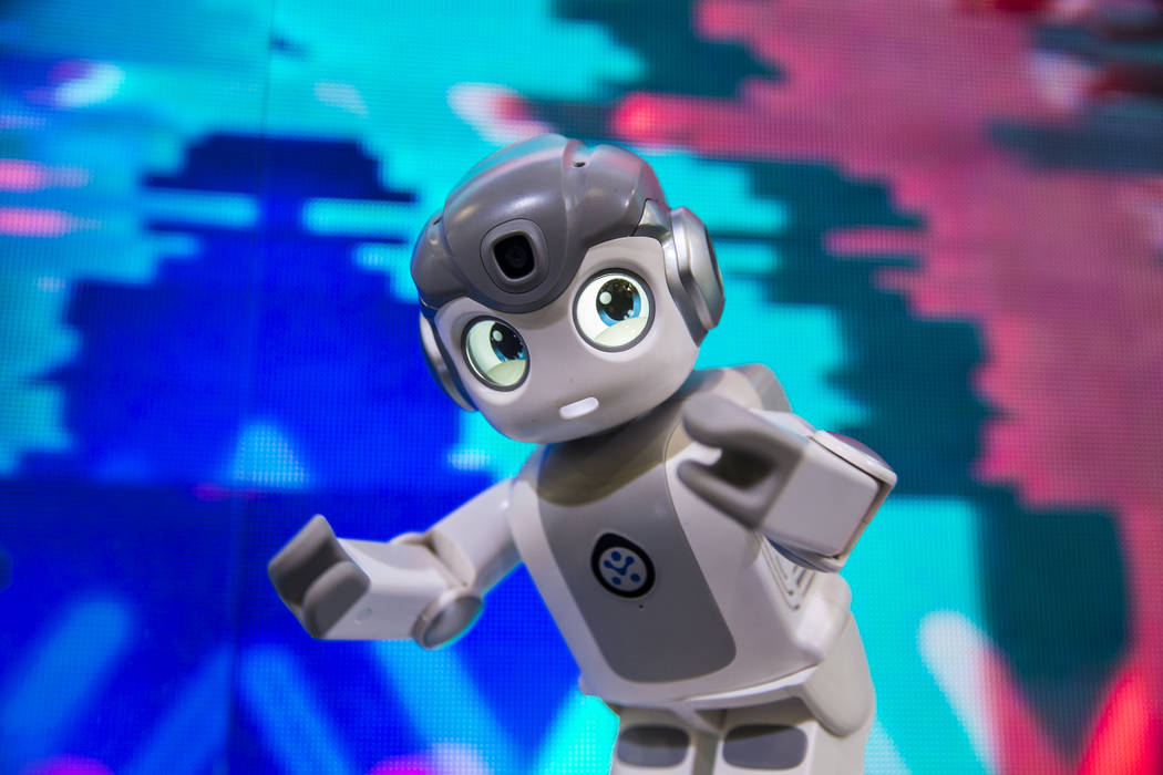 Ubtech's Alpha Mini intelligent companion dances during the first day of CES 2019 on Tuesday, Jan. 8, 2019, at the Las Vegas Convention Center, in Las Vegas. The four day tech event brings over 4, ...
