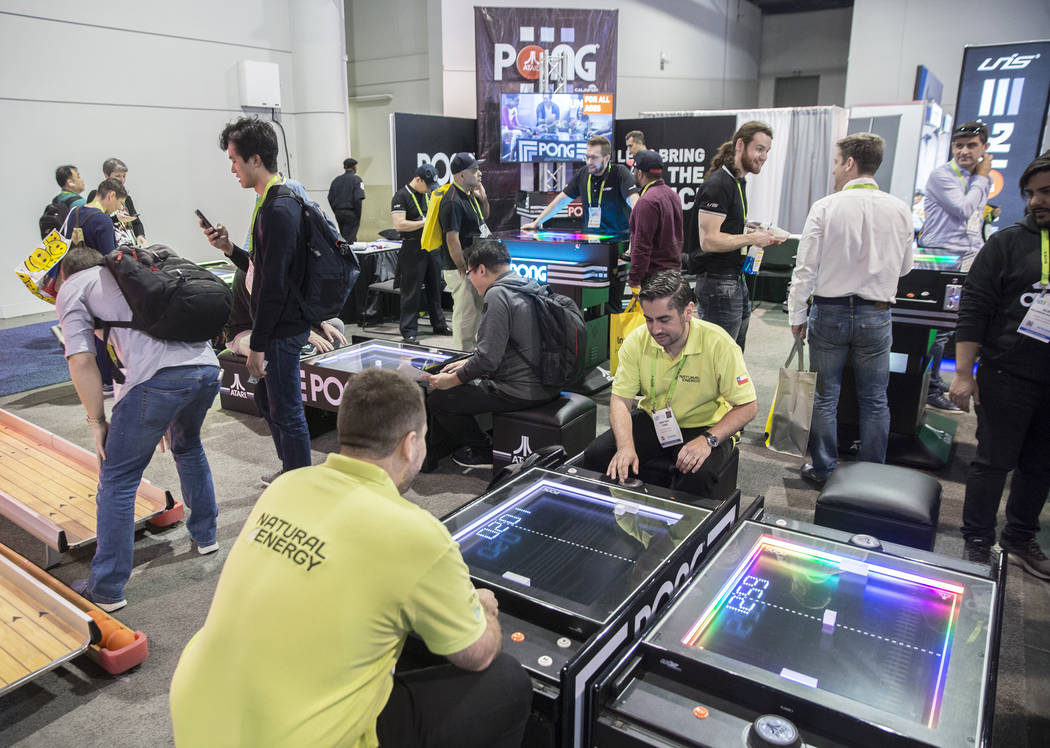 Convention goers play Pong during the first day of CES 2019 on Tuesday, Jan. 8, 2019, at the Las Vegas Convention Center, in Las Vegas. The four day tech event brings over 4,500 vendors and 180,00 ...